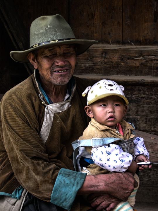 Grandfather and kid in tibet